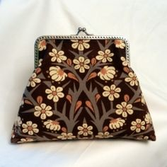 """A beautiful clutch purse made with vintage """"Blackthorn"""" by William Morris fabric."""