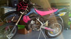 My PINK & BLACK Kawasaki KX100. I took the time to make my bike look the way I wanted it to. I drew out the fox head and marilyn stencils on pink vinal, then cut them out with a razor blade. I ordered the seat cover, black plastics, a couple of small stickers, and Kawasaki sticker on the swing arm. I love how it turned out!