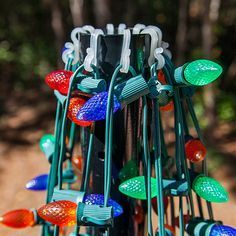 #DIY project for Christmas! Make a tree out of a basketball pole and colorful string lights. It's easy and fun, a great family project that creates a high impact outdoor Christmas lights display and can be done in any color combination or theme to match your existing outdoor Christmas decorations!
