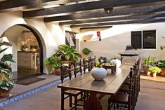lovely outdoor dining - complete with an arched doorway and fireplace!