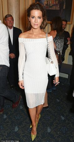 A bit of all white: Kate Beckinsale looks stunning in a white mesh dress at the opening ni...