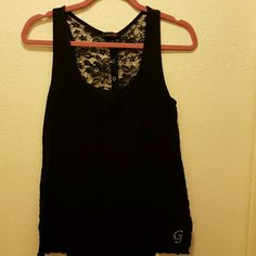 Guess black tank top Wore 5 times , it has black lace in the back Guess Tops Tank Tops