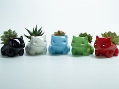Plastic is 100% non-toxic and has a nice shiny look. Ceramic monsters have a nice heft with a smooth, shin