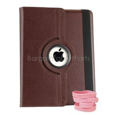 "Ipad 2 and Ipad 3 Rotating Case Color: Brown by Bargain Tablet Parts. $9.99. 360-Brown Color: Brown Features: -360 Rotation.-All of the iPad 2 and iPad 3 ports, buttons, speakers, and cameras are visible and accessible with the case on.-High quality case built specifically to fit the Apple iPad 2 and 3.-Smart cover to sleep saving you battery life. Construction: -Constructed of highest quality synthetic leather. Dimensions: -Dimensions: 10"" H x 7.5"" W x 0.75"" D."