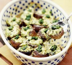 Baked mushrooms with ricotta & pesto - mmmm!  A mixture of these and the Pesto-Stuffed Mushrooms is delicious!