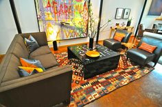 100-year-old kilim rug.Oil painting and sculpture: Ricardo Paniagua; coffee table: Phillips Collection; sofa: Donghia; chairs: Fusion Home