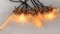 A set of 9 diverse Edison light bulbs with light by LightwithShade