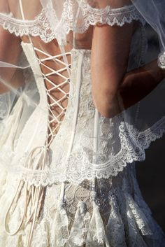 The whole thing is a little too much for me but I love the corset strings... Sexy but still classy