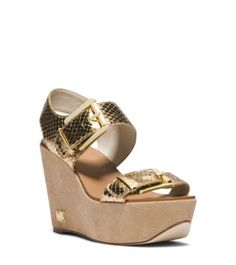 Take your style to new heights with our Warren wedges. Metallic, snake-embossed leather straps shine on these high-wattage sandals. Their curved soles provide comfort for hours on end—ideal for lively off-duty days and nights.