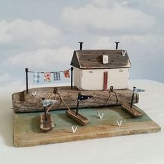 Crofters cottage, base is stormed damaged beach huts, that's been washed up. #driftwood #littlecottage #handpainted #harbour #shabbydaisies #seagulls #shabbychic #nautical #boats #seaside #driftwoodart #rustic #rusticart #washingline #washing #littlehouse #sun #summer #beach #sea