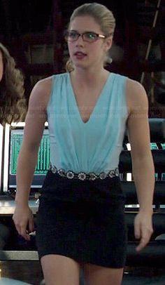 Felicity's light blue pleated v-neck dress with black skirt on Arrow.  Outfit Details: http://wornontv.net/41484/ #Arrow