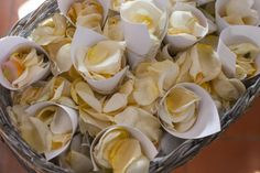 Freshly plucked rose petals in simple paper cones to throw over the happy couple as they leave the church, a natural and fragrant alternative to paper confetti.