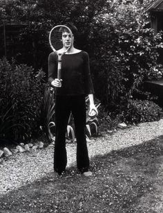 """Mick Rock remembers the 1971 backyard photo session: """"I think he felt less pressured; you can see the pictures of him with a tennis racket and there are quite a few pictures where he is laughing... I remember his mum bringing us tea and scones."""" Interview with Shane Gladstone, Clash Magazine."""