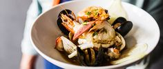 Andrew Zimmern makes a Japanese-style shellfish stew with dashi, sake and a few pats of butter that give it a rich umami mouthfeel.