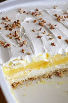 Easy cold lemon dessert (aka lemon lush) made with cream cheese and lemon pudding. Easy cold lemon dessert (aka lemon lush) made with cream cheese and lemon pudding. INGREDIENTS 1 cup flour cup butter cup pecans + extra for … 13 Desserts, Layered Desserts, Easy Lemon Desserts, Lemon Dessert Recipes, Health Desserts, Drink Recipes, Easy Delicious Desserts, Angel Food Cake Desserts, Cool Whip Desserts