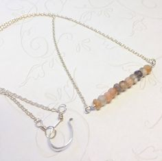 A personal favorite from my Etsy shop https://www.etsy.com/listing/527329279/moonstone-bar-necklace-sterling-silver