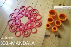 Geo-Mandala mit Kindern auf dem Boden legen mit den Geo-Legespielen nach Fröbel (hier Spielgabe 9, Froebel Gift 9)  -> Tutorial, 2. Schritt Spielgaben - Legespiele kaufen:  http://www.friedrich-froebel-online.de/shop/