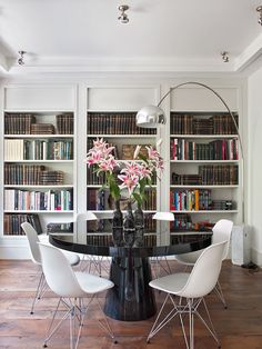 Built in book shelves-trim, crown and 'header'. http://www.isabellopezquesada.com/shop/