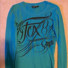 Teal Fox Riders Co. Thermal Teal in color with logo writing in black glitter! Awesome condition! Size large Fox Tops Tees - Long Sleeve