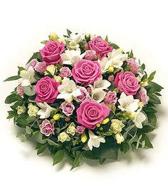Posies & Baskets come in a versatile variety of traditional and contemporary designs and can be sent directly to a funeral or sent as a tribute gift to a bereaved family. The 'Posy' is traditionally circular in shape allowing both flowers and foliage Funeral Bouquet, Funeral Flowers, Wedding Flowers, Arrangements Funéraires, Funeral Floral Arrangements, Wreaths For Funerals, Casket Sprays, Funeral Tributes, Sympathy Flowers