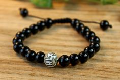 Dharmashop.com - Onyx and Om Mani Hand Carved Spacer Bead, $54.00 (http://www.dharmashop.com/onyx-and-om-mani-hand-carved-spacer-bead/)