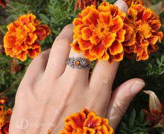 "Sterling silver and carnelian, flowery ""Twig ring"" by Drakonaria, Anna Mazoń. www.drakonaria.com https://www.etsy.com/shop/drakonaria"