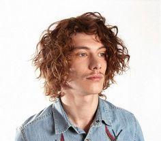 medium disheveled curly men's hairstyle