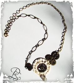 """This Steampunk necklace is 20"""" contrasting chains accenting the two tone metals  two stones accent the piece"""