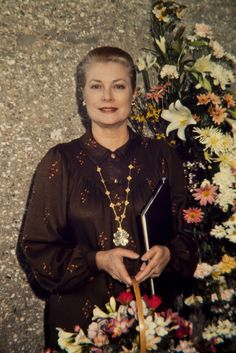 Princess Grace of Monaco c. 1980  Wearing Van Cleef & Arpels Alhambra necklace, with a pendant added.
