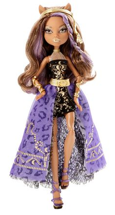Clawdeen looks magnificent with her long brown hair and stunning black mini dress. The dress features a pattern of gold crescent moons, a gold mesh halterneck, and a triple-layered open over-skirt. Monster High Toys, Love Monster, Monster Dolls, Purple Lantern, Purple Wedges, My Little Pony Dolls, High Hair, Long Brown Hair, Student Fashion