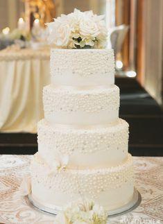 Elegant Destination Island wedding cake with white flowers