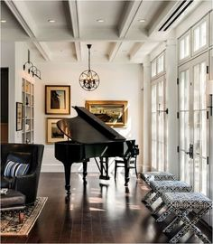 black grand piano room love the tools in front of window for extra seating. and more art on wall behind piano