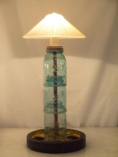 Mason Jar Lamp.....You wouldn't have to stack then because you can find tall Mason Jar's at flea markets and such.