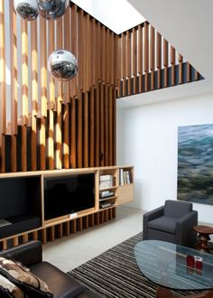 Love how the wood detail adds visual interest to this living room. The TV is on a media stand that provides storage space for Blu-rays, game consoles, etc...