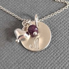 The hand stamped sterling silver initial disc pendant with puffed heart charm and rondelle birthstone is tiny, simple and a perfect personalized necklace for a new Mom with a baby's initial and birthstone, or a gift idea for a teen or tween girl. Personalized Initial Necklace with heart and birthstone, gift idea for new Mom with baby's initial and birthstone, or tween teen girl daughter. Family Necklace, Name Necklace, Initial Necklace, Tween Gifts, Birthstone Necklace, Personalized Necklace, Heart Charm, Hand Stamped, Birthstones