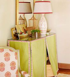 Use a table skirt to cover hidden storage. Better Homes and Gardens Skirted Hall Table. For more great ideas, go to http://decoratingfiles.com/2012/08/10-ideas-for-decorating-with-table-skirts/