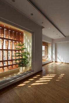 Admun Design & Construction Studio-Cloaked in Bricks