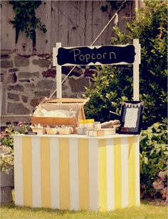 have a popcorn station for guests to enjoy snacks  http://www.weddingchicks.com/2013/10/30/country-wedding-2/