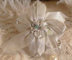Circa 1920s Whisper Blue Silk Ribbonwork Rosette Lingerie Pin