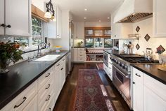 awesome Kitchen in Spanish Revival home with white cabinets, soapstone counters, stainle. Spanish Home Decor, Home Appliances, Home, Galley Kitchen Remodel, Kitchen Remodel, New Kitchen, Kitchen Redo, Home Kitchens, Kitchen Design