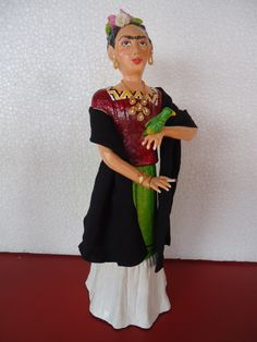Doll Frida Kahlo in paper mache , with parrots and cigarette in hand ... by Ruiy Moura