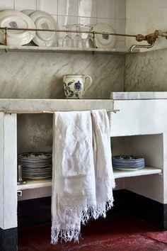 Rough marble countertop slabs - Brass faucet and shelf railing - Open shelving below sink - Rustic, farmhouse, European, wabi sabi kitchen - Photo by Alessandra Ianniello