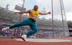 Australia's Scott Martin competes during his men's discus throw qualification at the Olympic Stadium