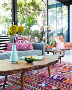 This bright happy space by @em_henderson is full of personality love the kilim rug and use of global textiles