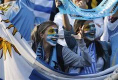Uruguay soccer fans shout before a Copa America quarterfinal match between Argentina and Uruguay in Santa Fe, Argentina, Saturday July 16, 2011. (AP P