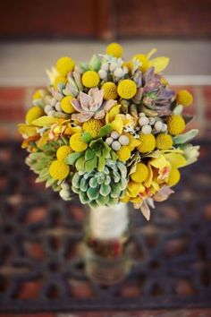 yellow polka dot bouquet of craspedia, succulents and silver brunia