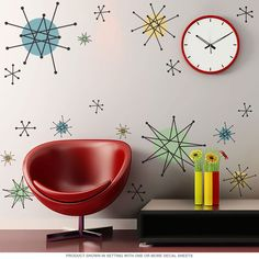Retro wall decals featuring Atomic Age starbursts. Made in USA. 20 peel and stick wall stickers are easy to apply. They adhere to most any flat surface and give instant vintage appeal to a kitchen or dining room. Polyester fabric decals with a matte finish. Shapes range 2.5