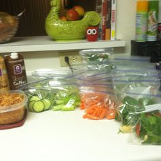 Two weeks worth of clean eating breakfasts and lunches. Green smoothie bags for freezer, fresh veggies and salsa chicken for lunches.