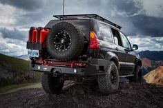The Lexus rear swing out bumper features a tire carrier, side wing support, hi-lift jack mount, and more. Order this bumper for your Lexus today. Land Cruiser 120, Toyota Land Cruiser Prado, Lexus Gx470, Lexus Cars, Hi Lift Jack Mount, Toyota Lc, Led Step Lights, Land Rover Discovery, Monster Trucks