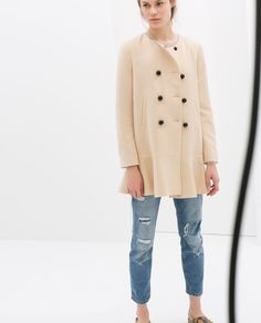 COAT WITH ROUND NECK AND FRILLY HEM from Zara